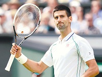 Novak Djokovic of Serbia reacts after defeating Juan Carlos Ferrero of Spain in their men's singles tennis match at the Wimbledon tennis championships in London